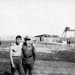 Недалеко от 9-го ангара, в котором размещалась абитура. Поле, ангар, туалет, курилка, волейбольная площадка - вот и весь интерьер того места в 1970 году